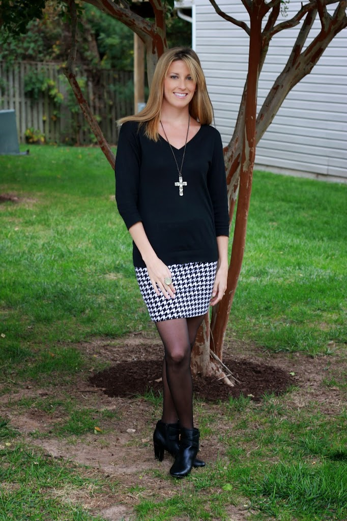 The perfect houndstooth skirt, black sweater and ankle booties.