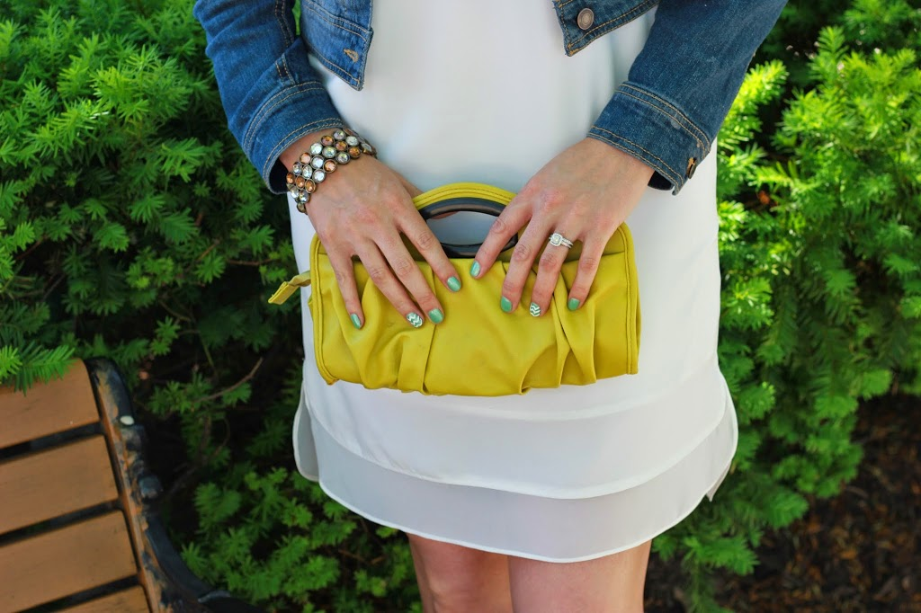 A great little white dress with a denim jacket, ankle booties and mustard clutch.