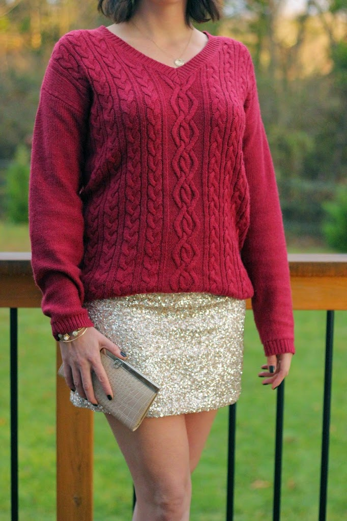 A holiday party style with a sequin skirt and oversized sweater.