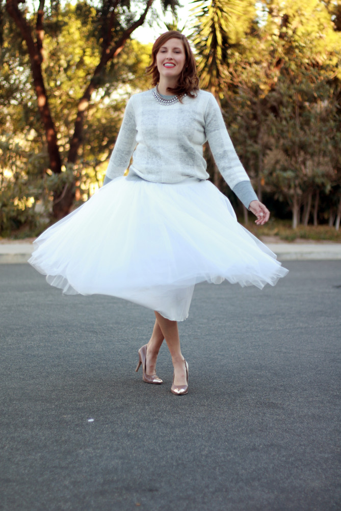 holiday style with a tulle skirt and sweater.