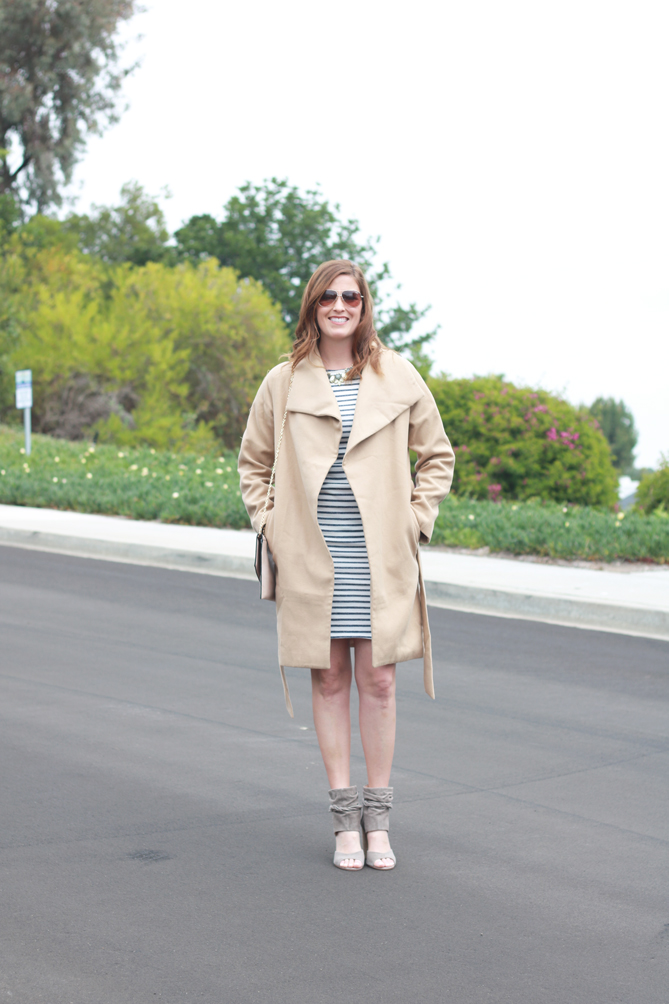 The perfect camel jacket paired with a striped dress. A great look for Spring brunch.