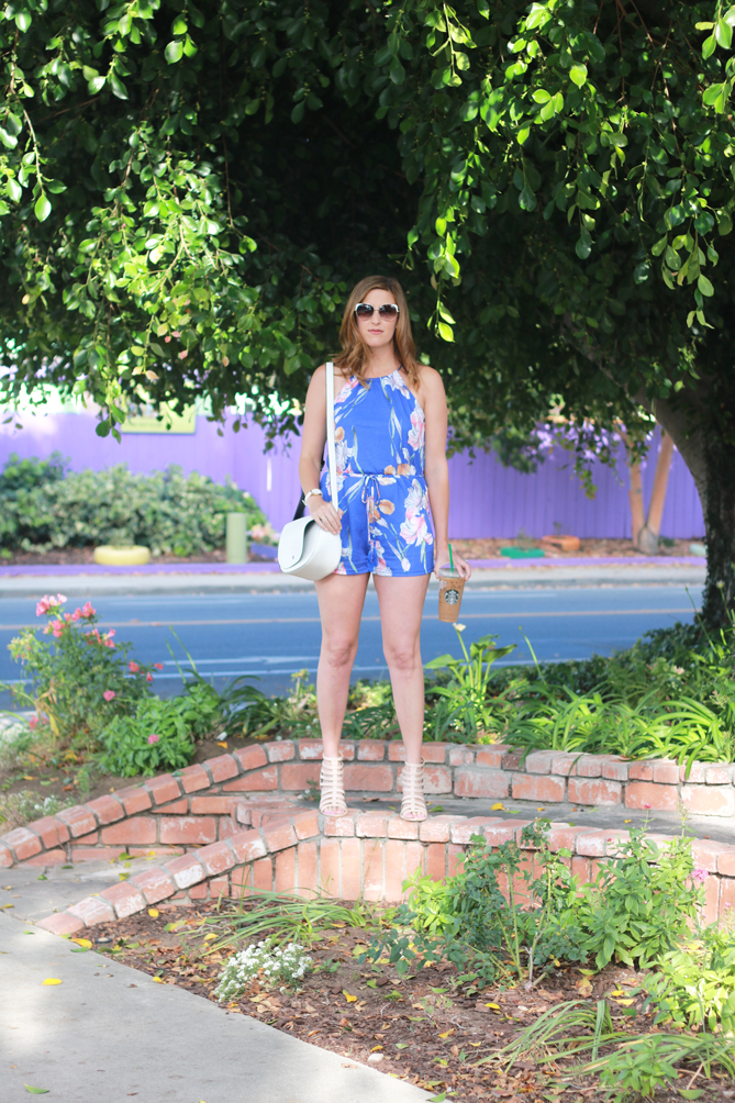 Floral printed romper and neutral accessories. The perfect summer look. - The Fashionista Momma