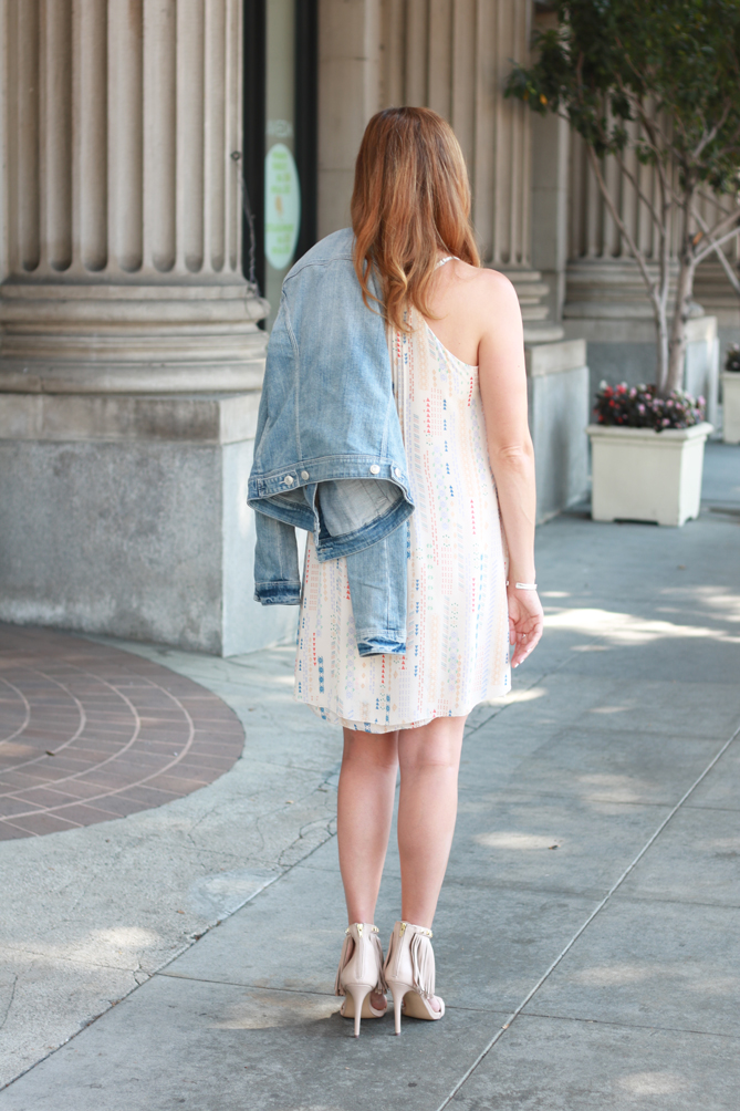 Printed dress, denim jacket and fringe heels. A date night look or day out on the town.