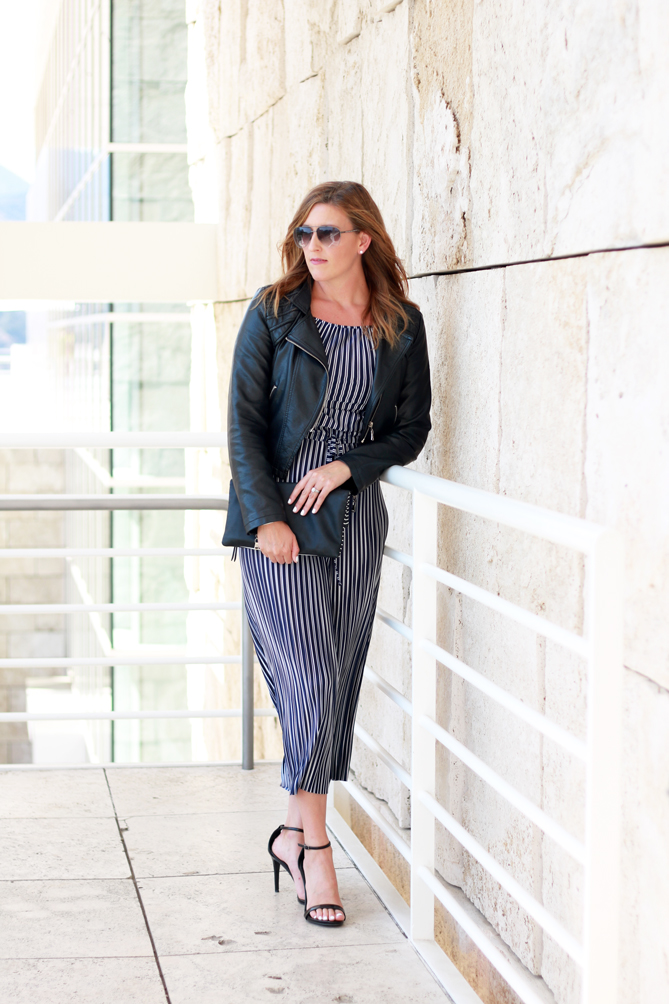 Striped Jumpsuit paired with a leather jacket and strappy heels. A perfect date night outfit.