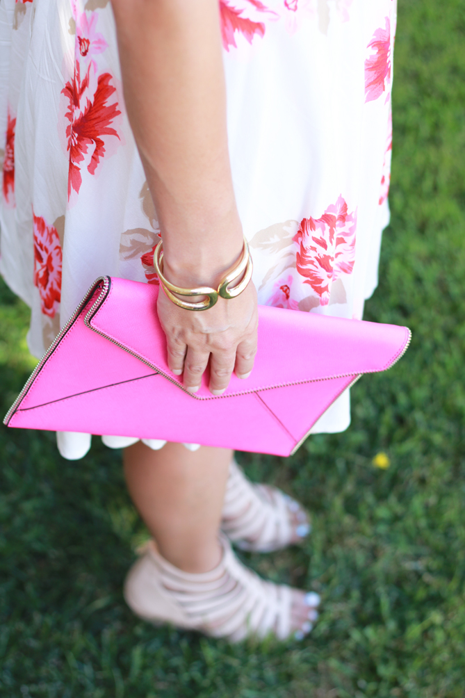 Floral printed dress with a hot pink clutch and beaded headband. - The Fashionista Momma