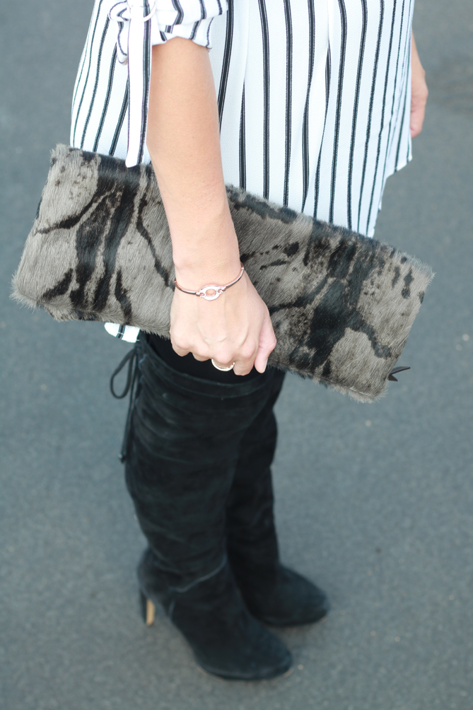A black and white striped tunic with thigh high boots and leather leggings.  - The Fashionista Momma