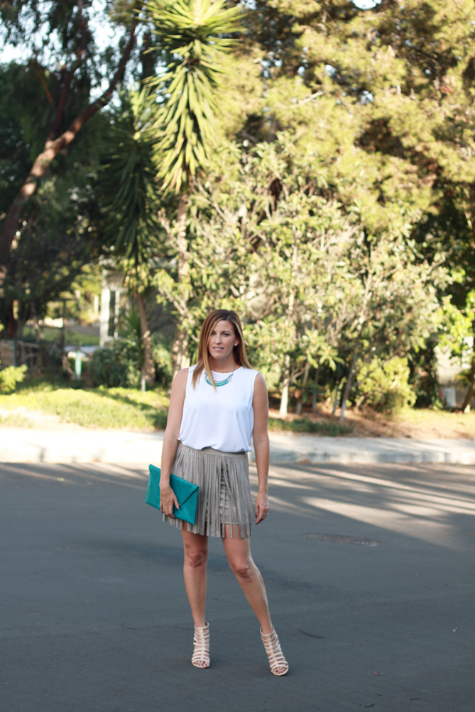 The perfect fringe skirt with snake skin clutch.