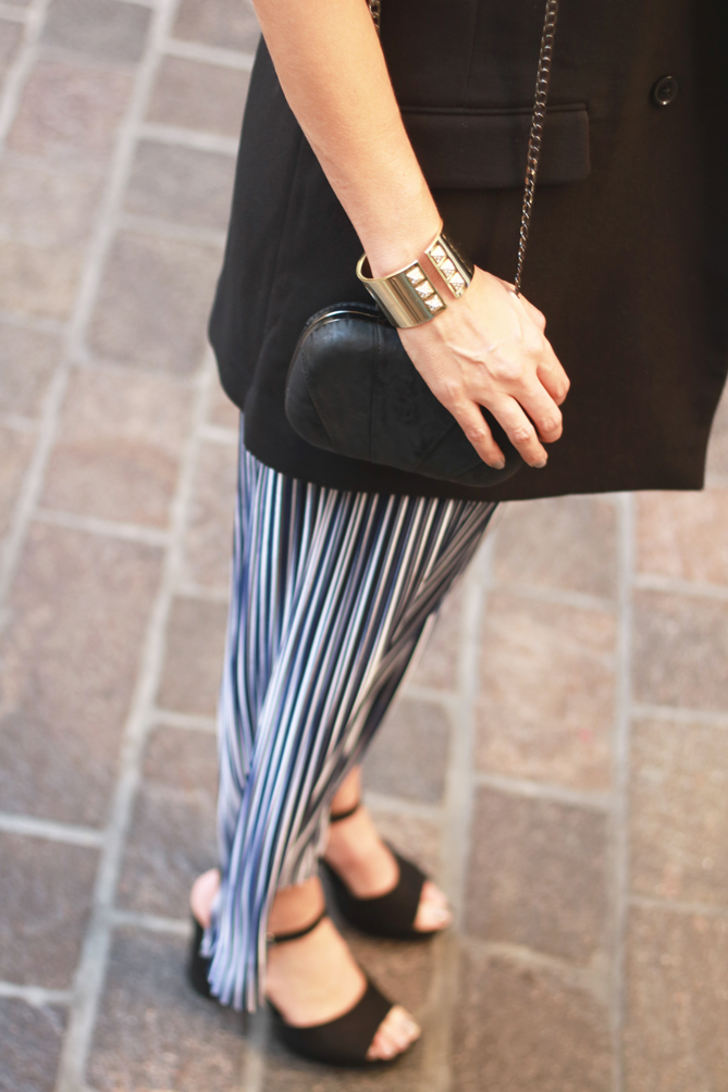 The Fashionista Momma shares a striped jumpsuit and a vest. - The Fashionista Momma