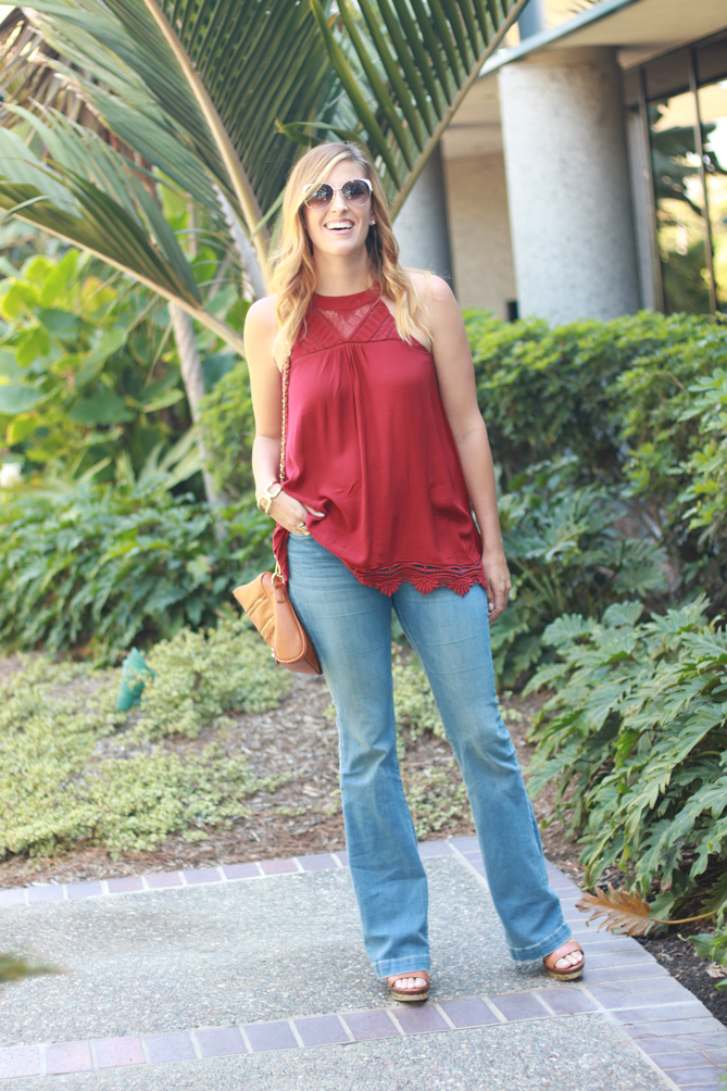 The Fashionista Momma styles wide leg jeans with a crochet detailed top that's perfect for fall.