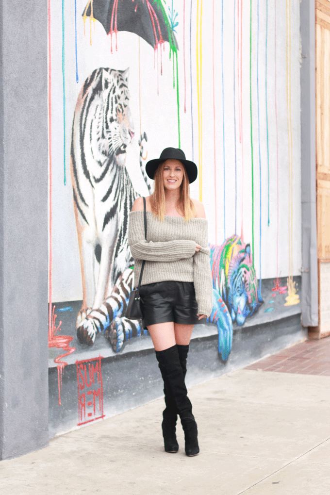 The perfect off the shoulder sweater paired with leather shorts and over the knee boots. - The Fashionista Momma - Off Shoulder Sweater & Leather by popular Los Angeles fashion blogger The Fashionista Momma