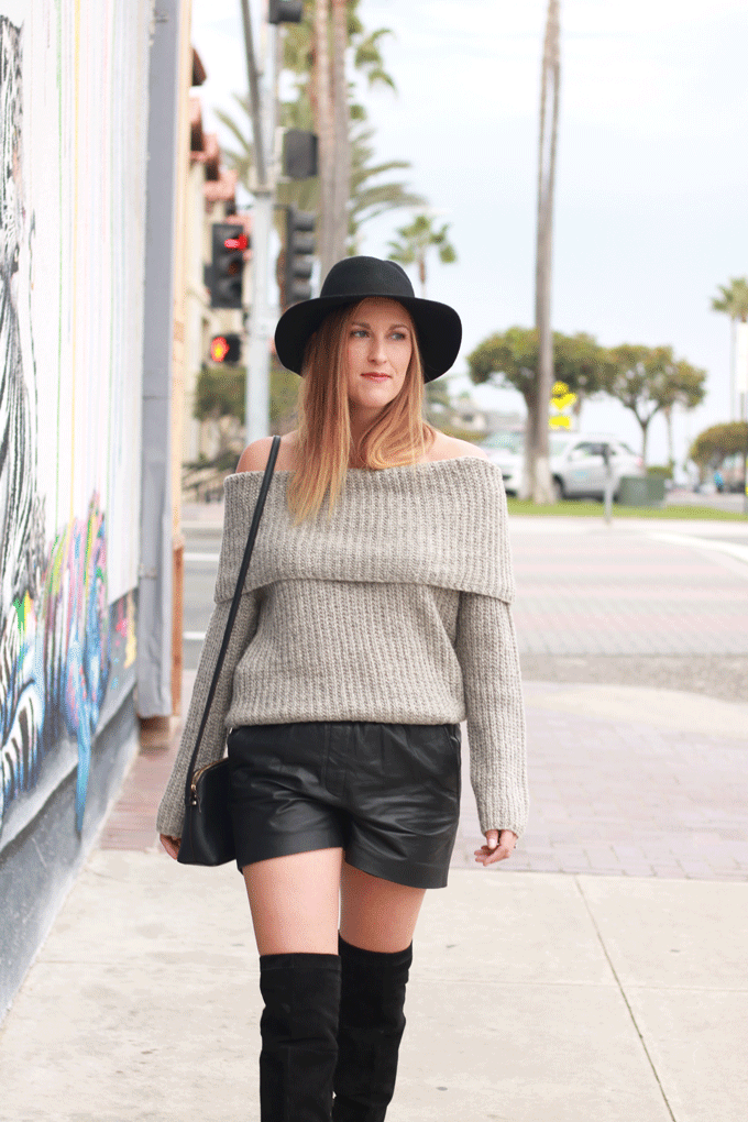The perfect off the shoulder sweater paired with leather shorts and over the knee boots. - The Fashionista Momma