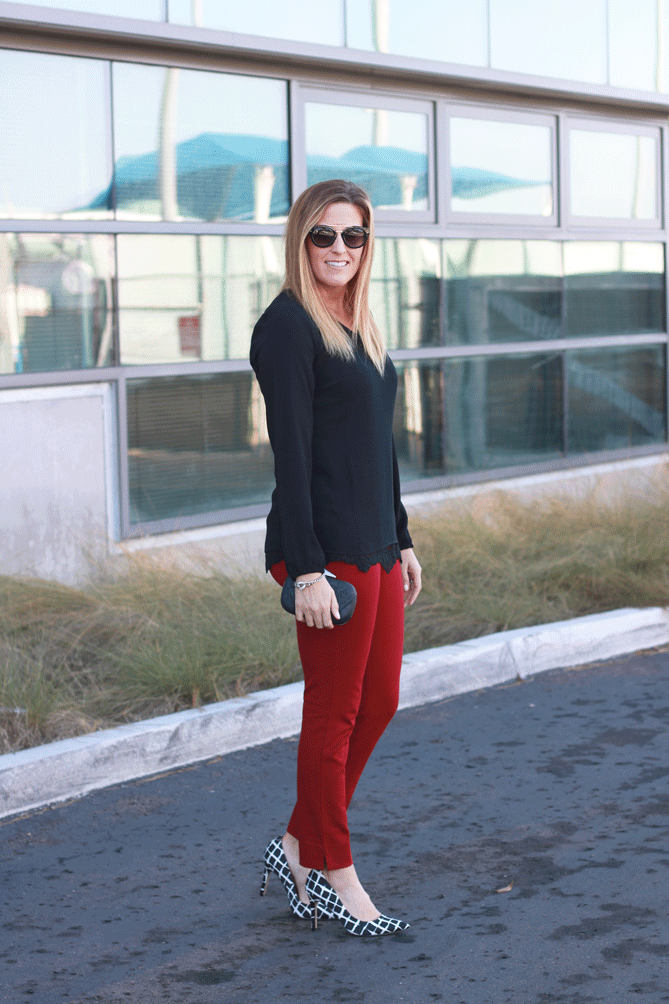 The Fashionista Momma shares a look for the holidays from Cabi with red trousers and lace.
