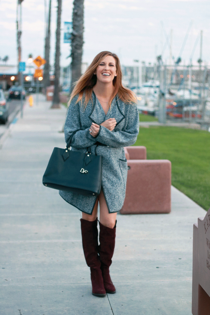 A sweater jacket as a dress. The perfect look for fall paired with suede boots.