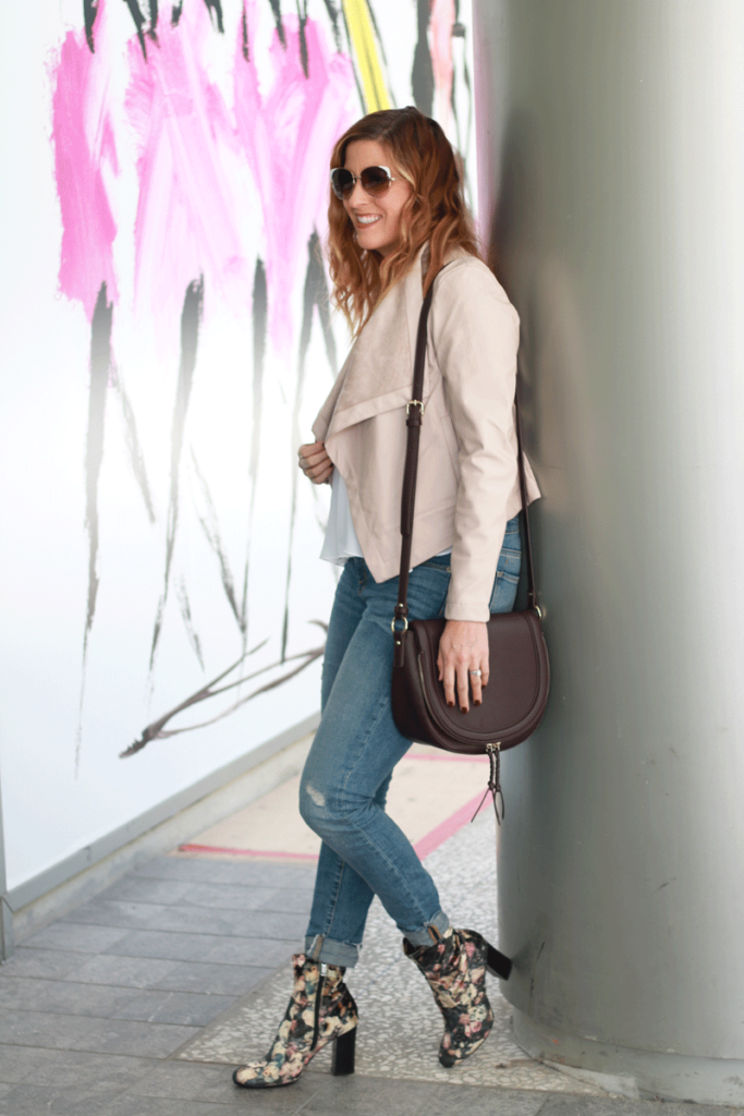 A blush faux leather jacket and velvet floral boots. A great ootd.
