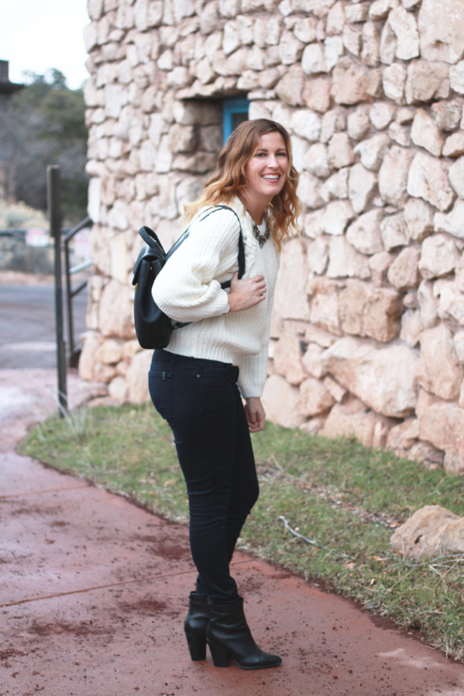 A cozy cream sweater with black jeans.  - Cable Knit Sweater styled by popular Los Angeles fashion blogger, The Fashionista Momma