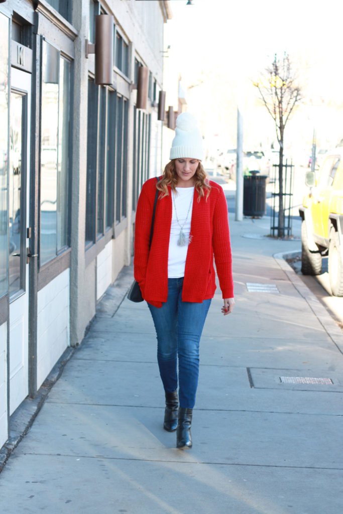 The red cardigan and beanie perfect for the holidays.