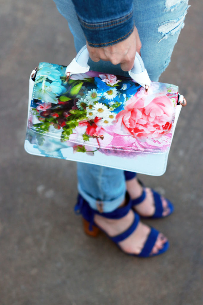 Floral purse with denim on denim.