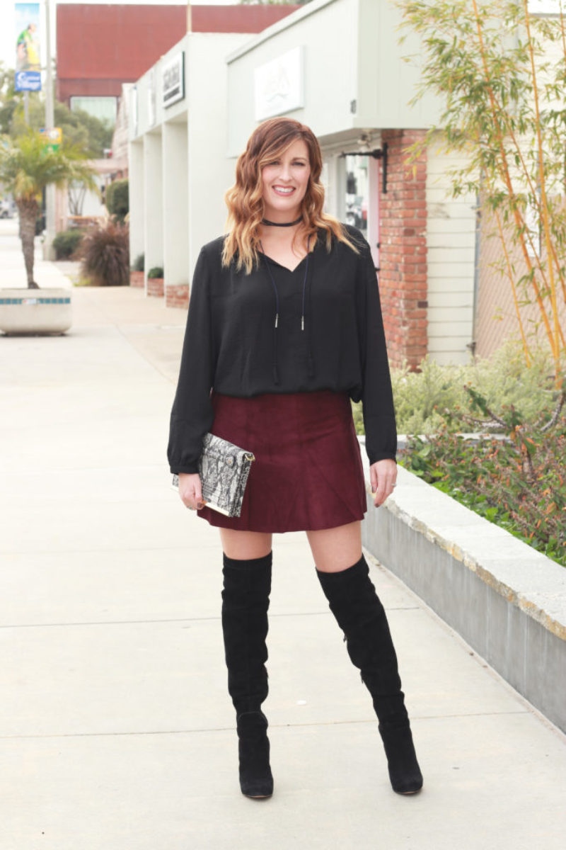 A velvet skirt and over the knee boots.