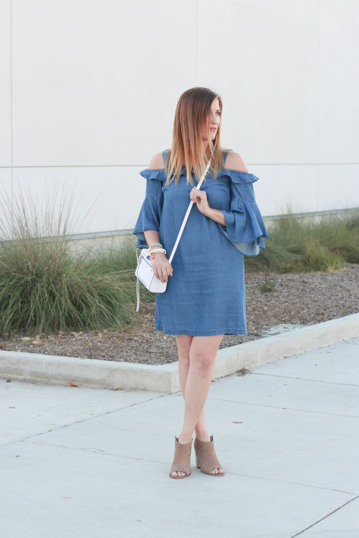 The perfect cold shoulder chambray dress with ankle booties. The perfect cold shoulder chambray dress with ankle booties.