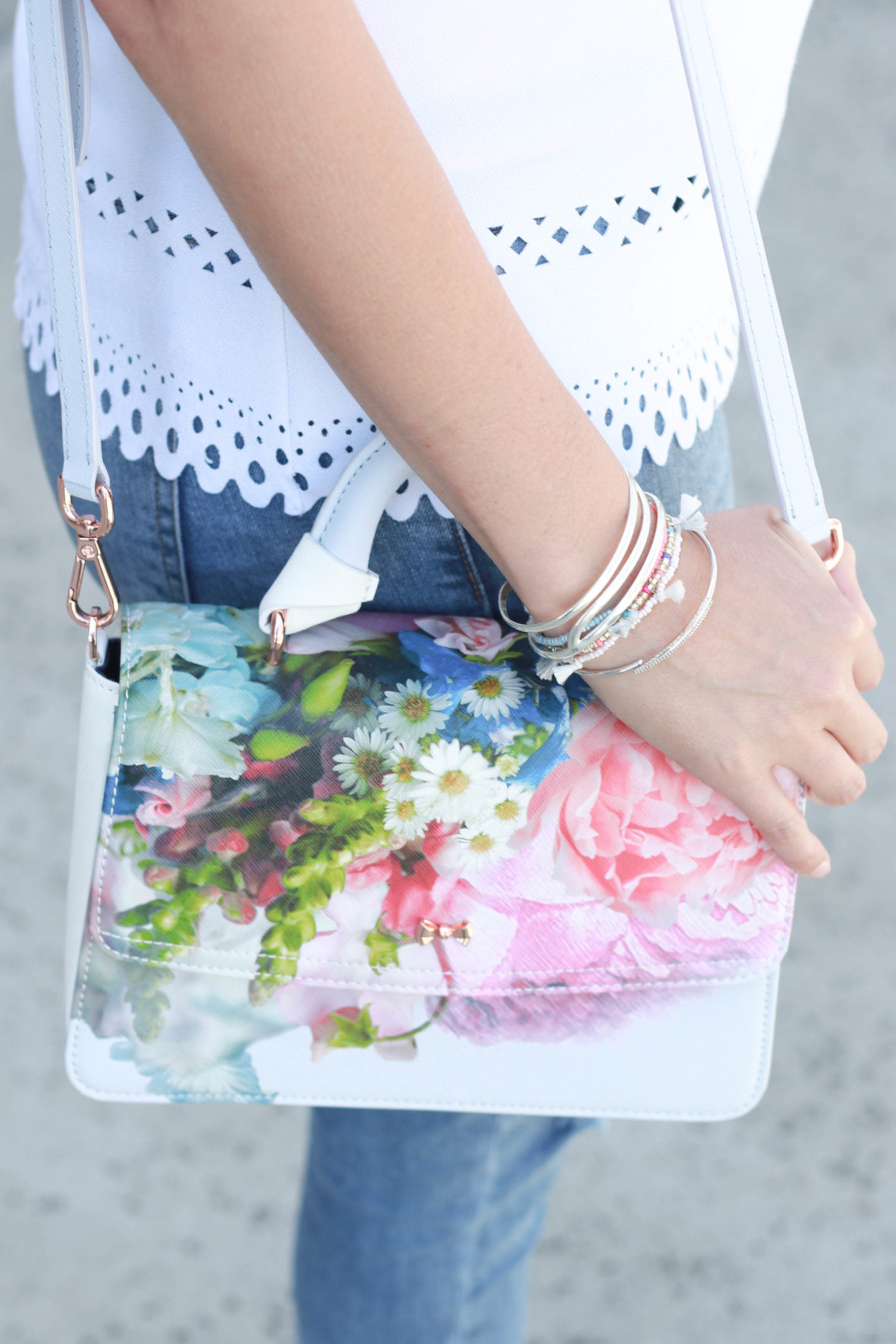 Fringe denim for spring with a floral printed purse and eyelet top.