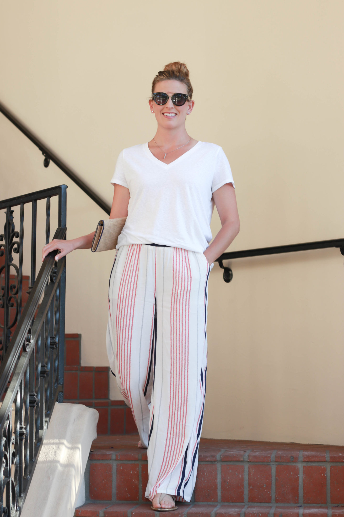 Straw bag with palazzo pants and a t-shirt. A perfect summer outfit. - 4th of July Outfit Idea featured by popular Los Angeles fashion blogger, The Fashionista Momma