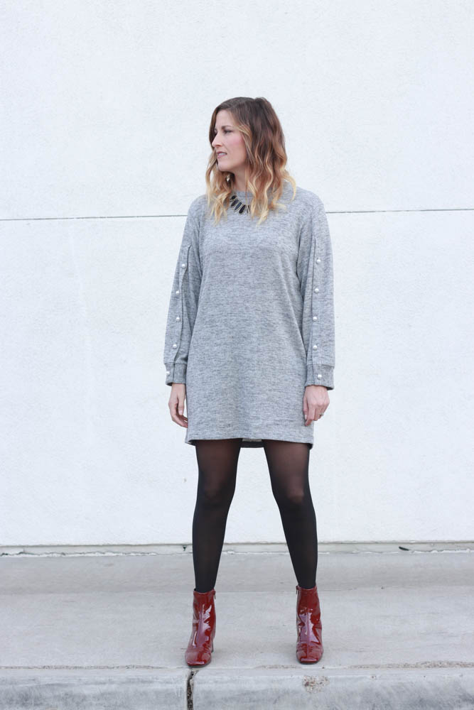 A great grey sweater dress with pearl sleeve detail and red patent leather boots.