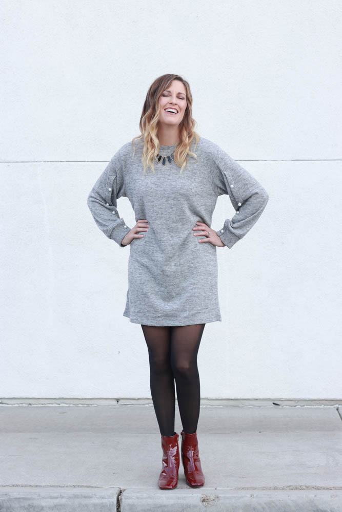 A great sweater dress with pearl sleeve detail and red patent leather boots. - Grey Sweater Dress by popular Los Angeles fashion blogger The Fashionista Momma