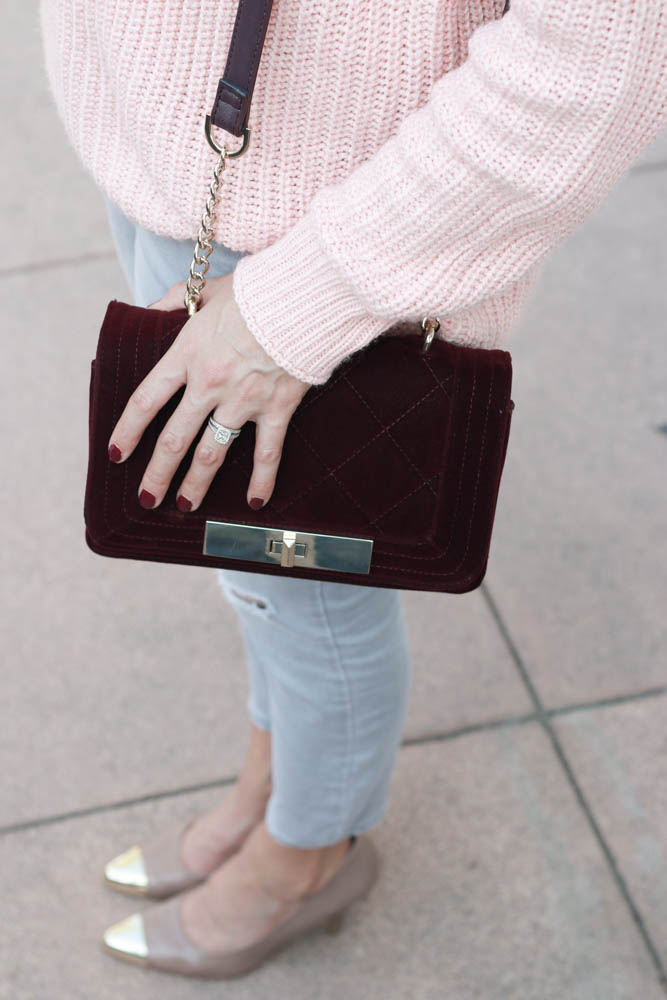 A great blush sweater and burgundy velvet crossbody bag.