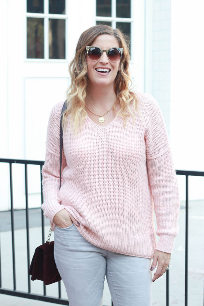 A great blush cozy sweater and burgundy velvet crossbody bag.