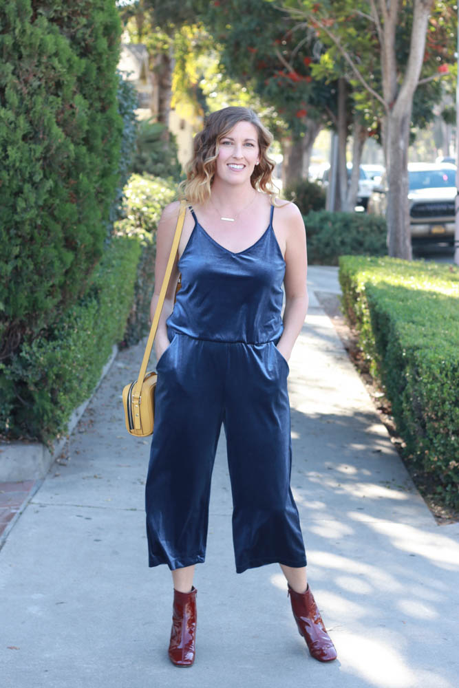 A perfect velvet jumpsuit with red patent leather boots and mustard purse. - Blue Velvet Jumpsuit by popular Los Angeles fashion blogger The Fashionista Momma