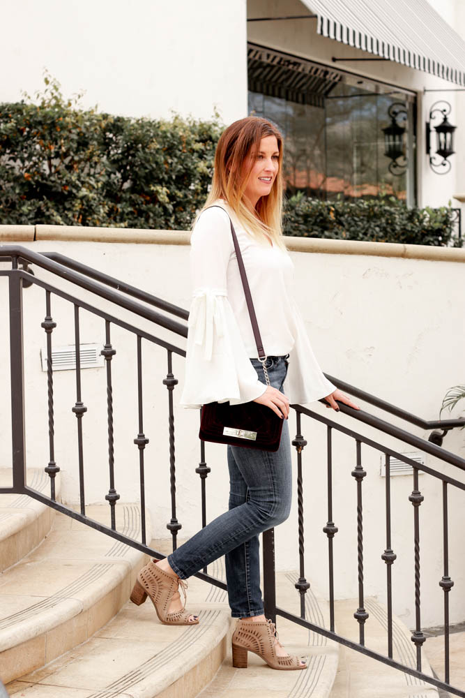 The perfect white bell sleeve top with jeans and a velvet purse. - Shopbop Bell Sleeve Top by popular Los Angeles fashion blogger The Fashionista Momma
