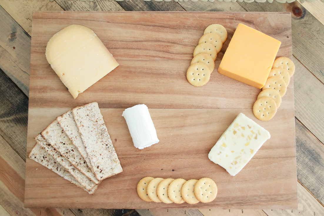 A Delicious Vegetarian Charcuterie Board featured by popular Los Angeles lifestyle blogger, The Fashionista Momma: different cheeses and crackers