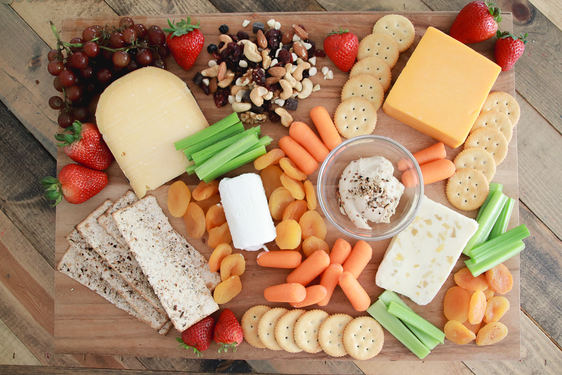 A Delicious Vegetarian Charcuterie Board featured by popular Los Angeles lifestyle blogger, The Fashionista Momma: different cheeses, crackers, proteins and produce