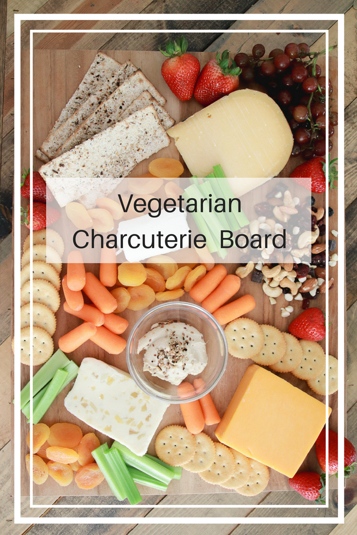 A Delicious Vegetarian Charcuterie Board featured by popular Los Angeles lifestyle blogger, The Fashionista Momma: different cheeses, crackers and proteins
