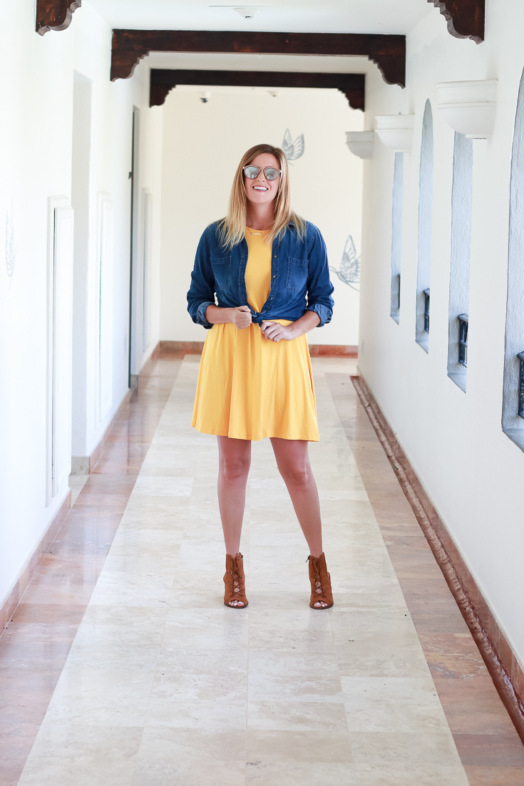 The perfect transitional fall outfit with a chambray top, dress and ankle boots.