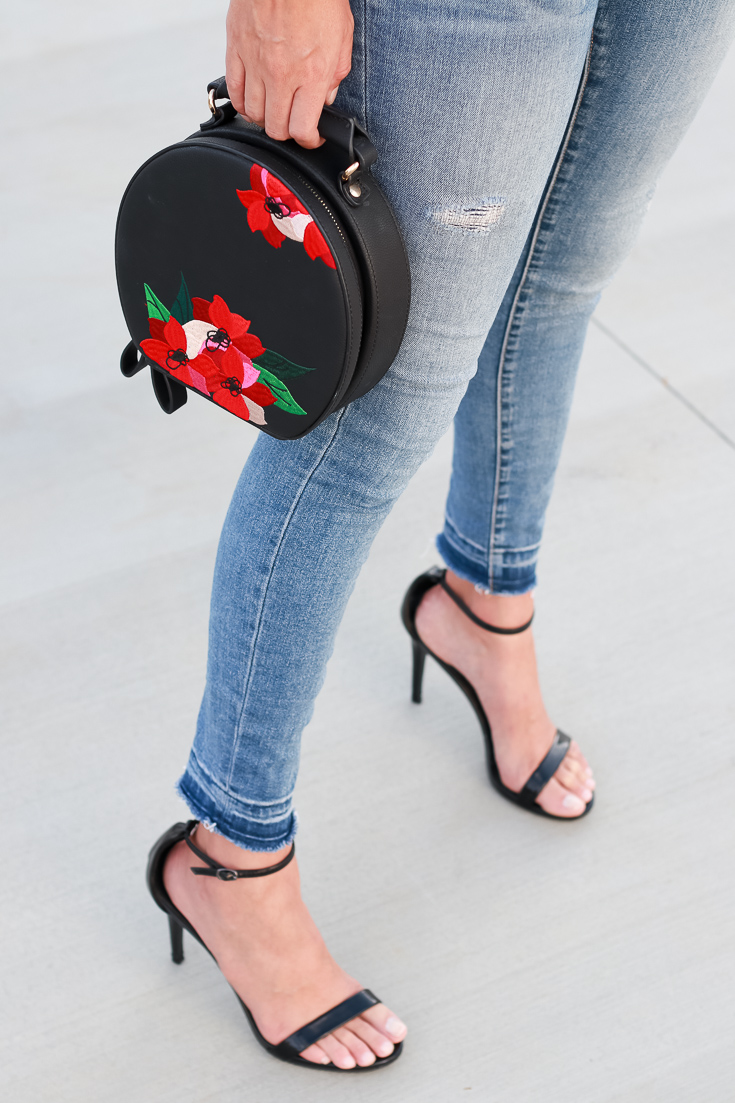 Popular Los Angeles blogger, The Fashionista Momma, styles a black lace cami, denim and black heels for a date night.