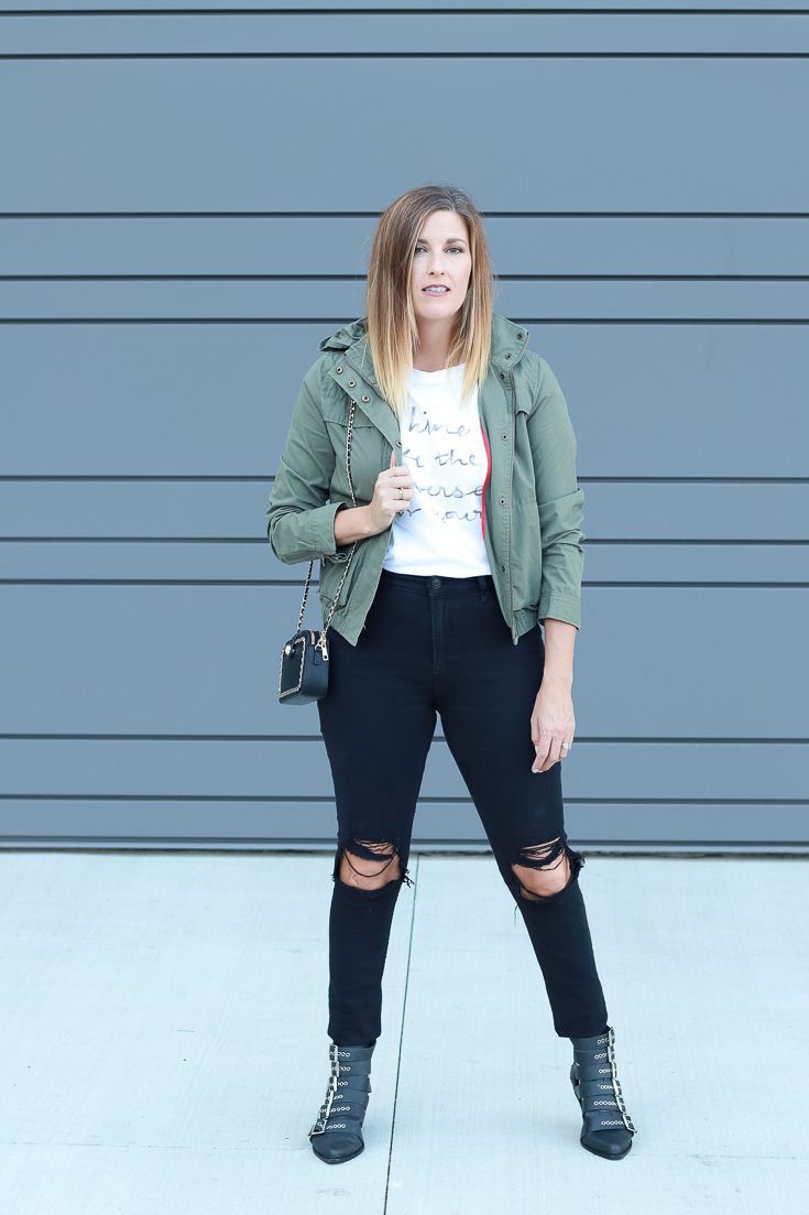 The Fashionista Momma shares hooded military jacket with a graphic tee and black denim.