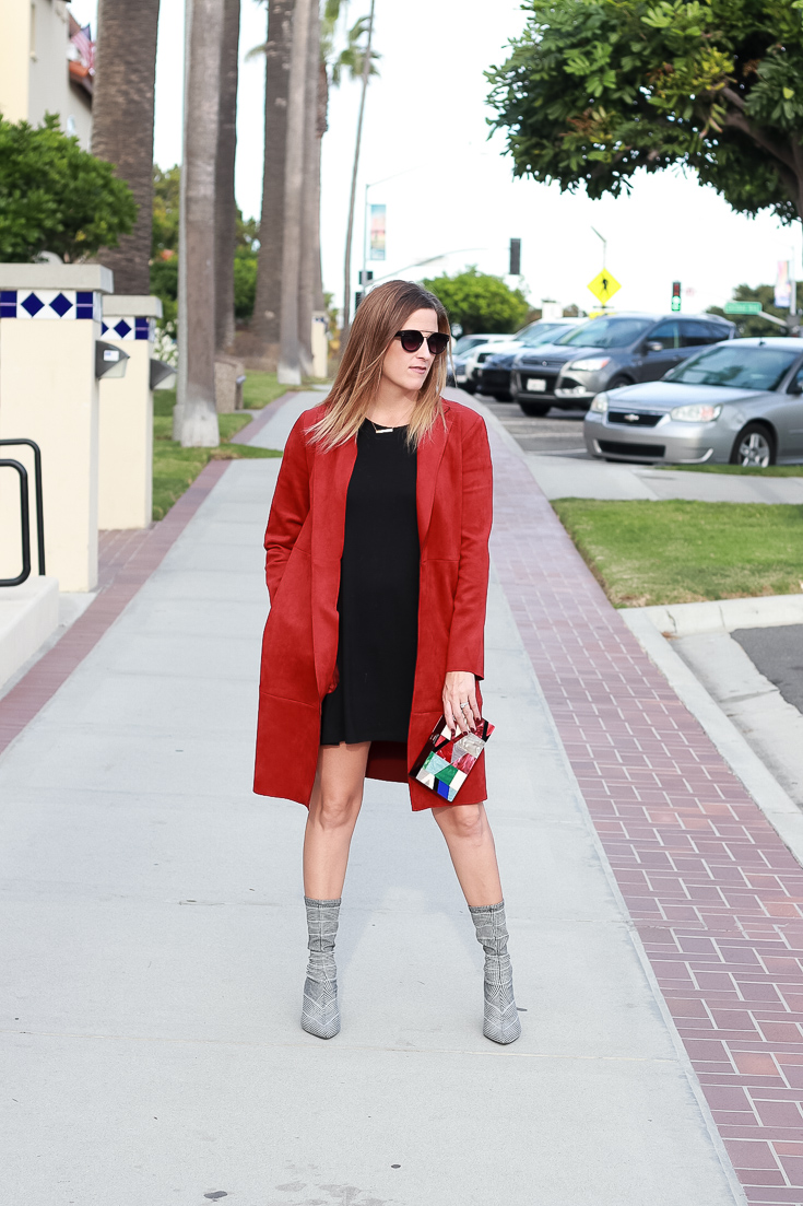 The Fashionista Momma shares the perfect pair of sock ankle boots with a dress and suede jacket.
