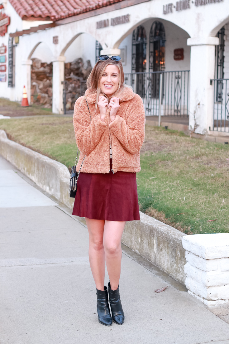 The Fashionista Momma shares a teddy bear jacket, suede skirt and ankle boots.