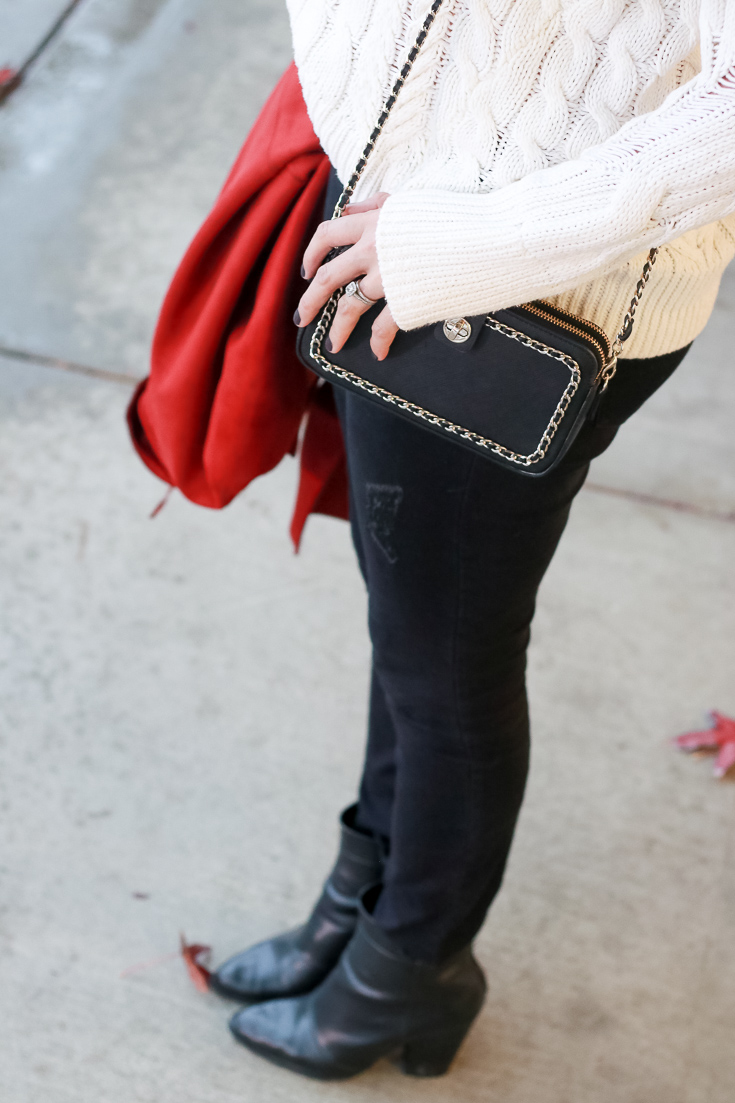 The Fashionista Momma styles a white chunky sweater with a rust suede jacket and black jeans.