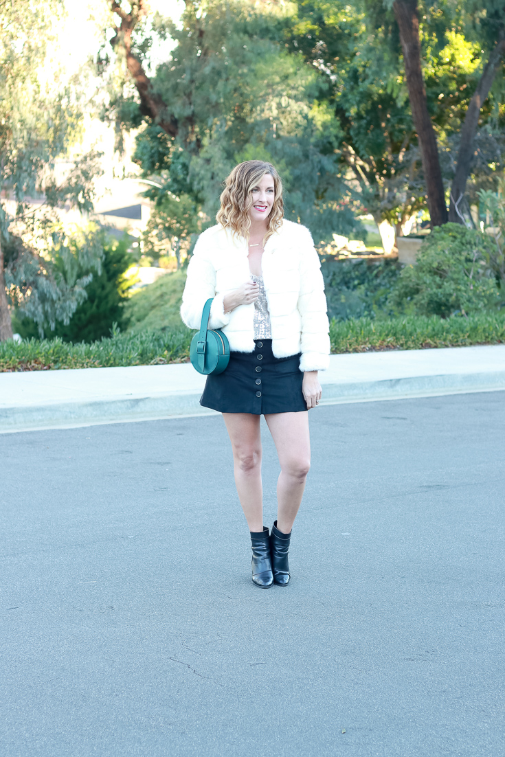 The Fashionista Momma styles a sequin top with a suede skirt and fur coat.