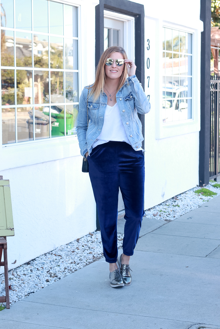 The Fashionista Momma styles velvet joggers and a denim jacket.