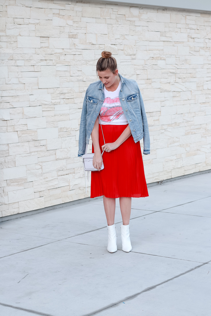 The Fashionista Momma styles a red skirt, graphic tee and denim jacket.
