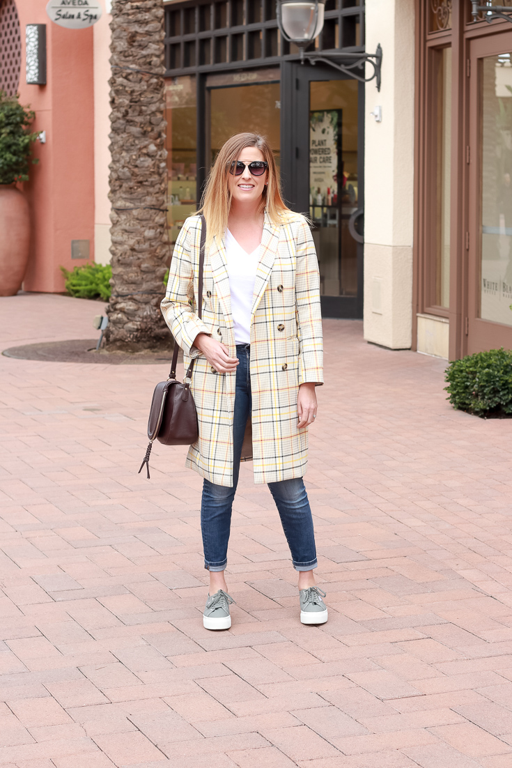 The Fashionista Momma styles a plaid jacket and Superga sneakers for the perfect spring transition outfit.