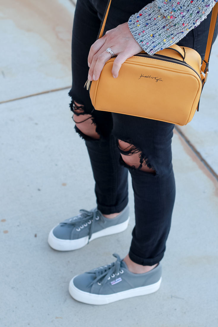 The Fashionista Momma shares a cozy sweater with sneakers.