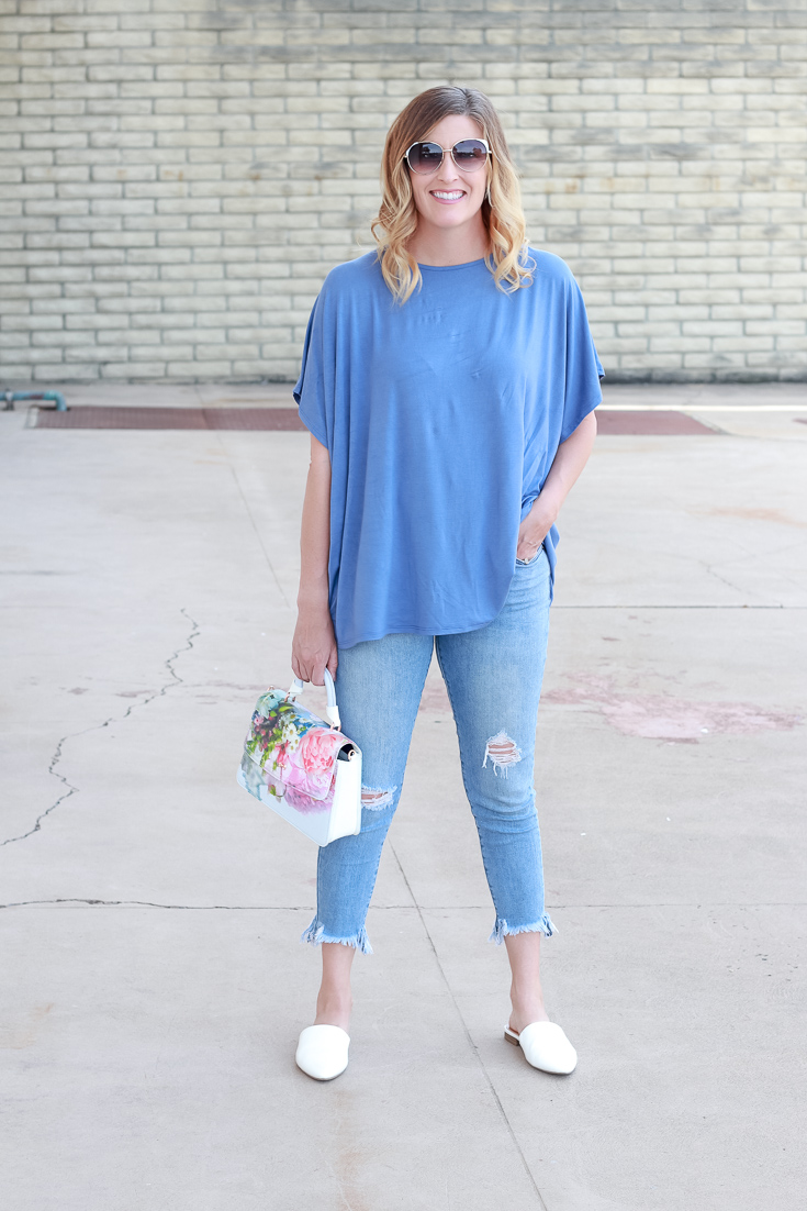 The Fashionista Momma styles a blue top from PinkBlush and a floral purse.