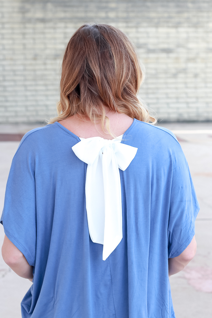 The Fashionista Momma styles a bow detail top from PinkBlush.