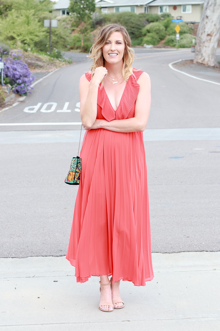 The Fashionista Momma shares an orange dress that is perfect for a night out.