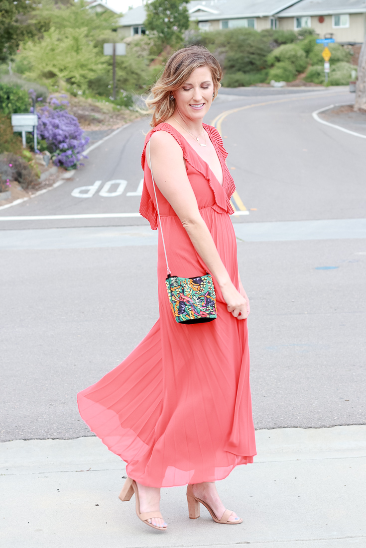 The Fashionista Momma shares an orange dress that is perfect for a night out or special event.