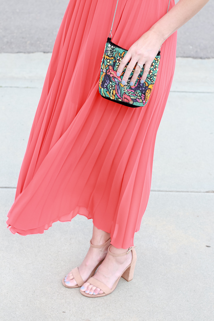 The Fashionista Momma styles a beaded purse for a night out.